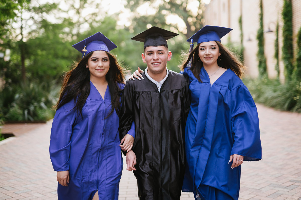 three high school seniors walking in San Antonio by high school senior photographer