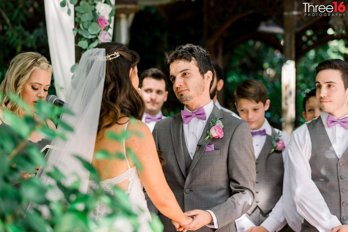 Groom stares into his Brides eyes at the altar