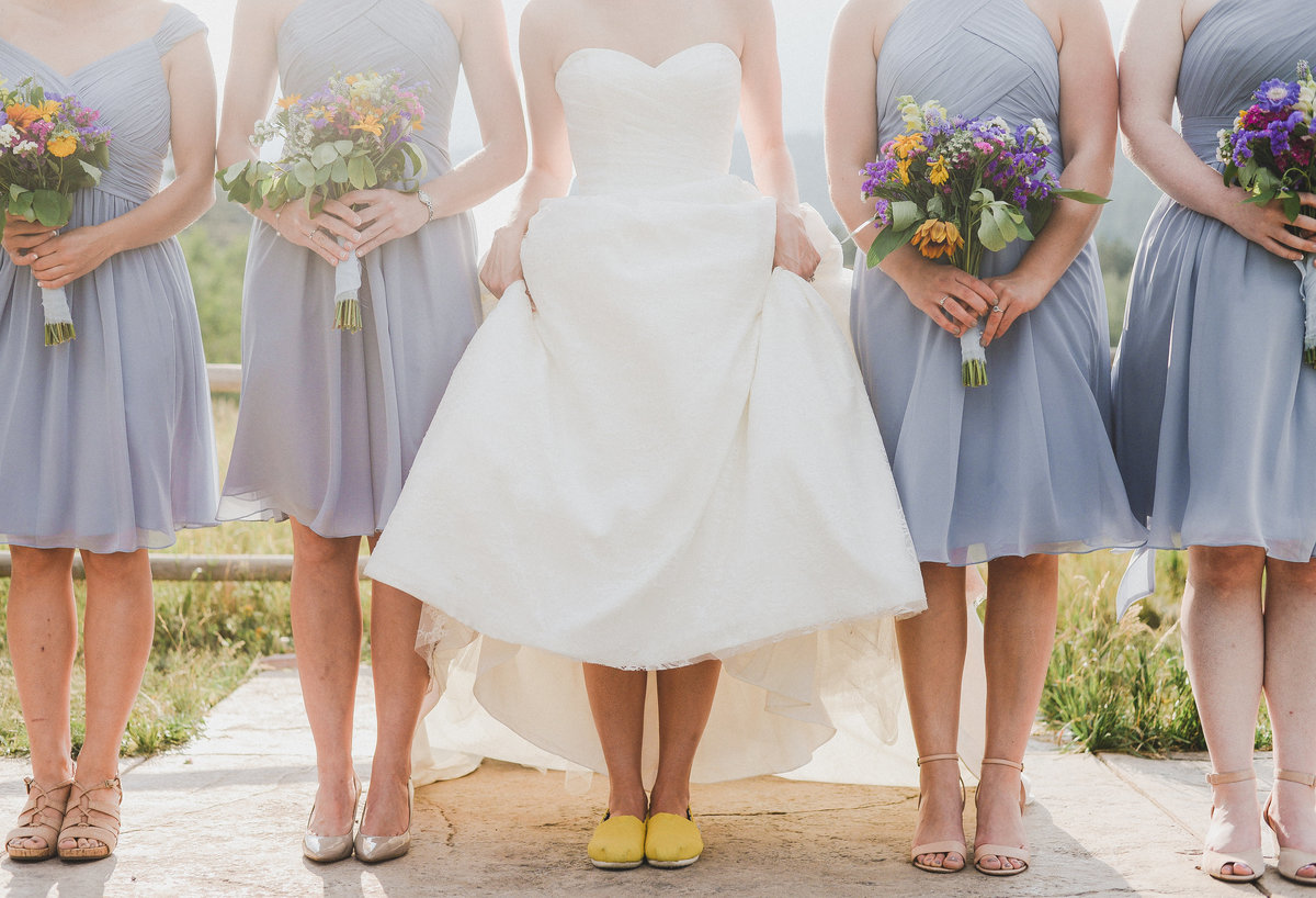 Bride with bridesmaids in lilac dresses