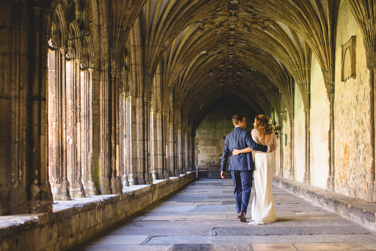 bride and groom walking after wedding at canterbury cathedral