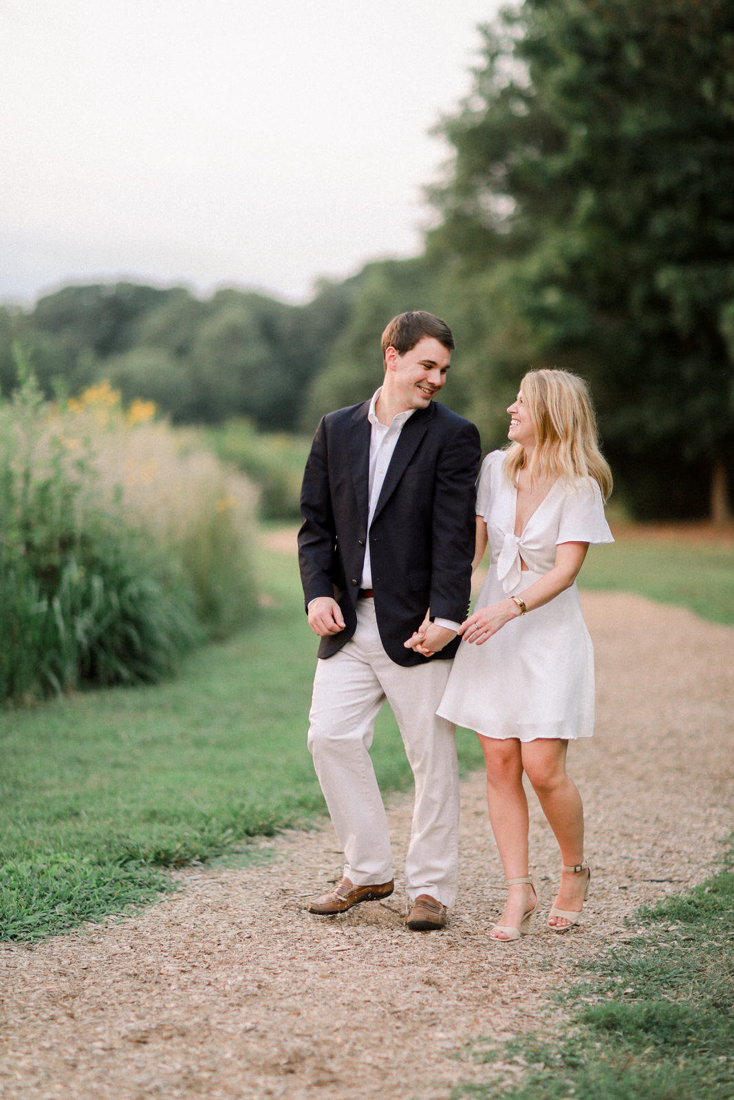 An engaged couple poses for their engagement photography session at Reynolda Gardens in Winston-Salem.