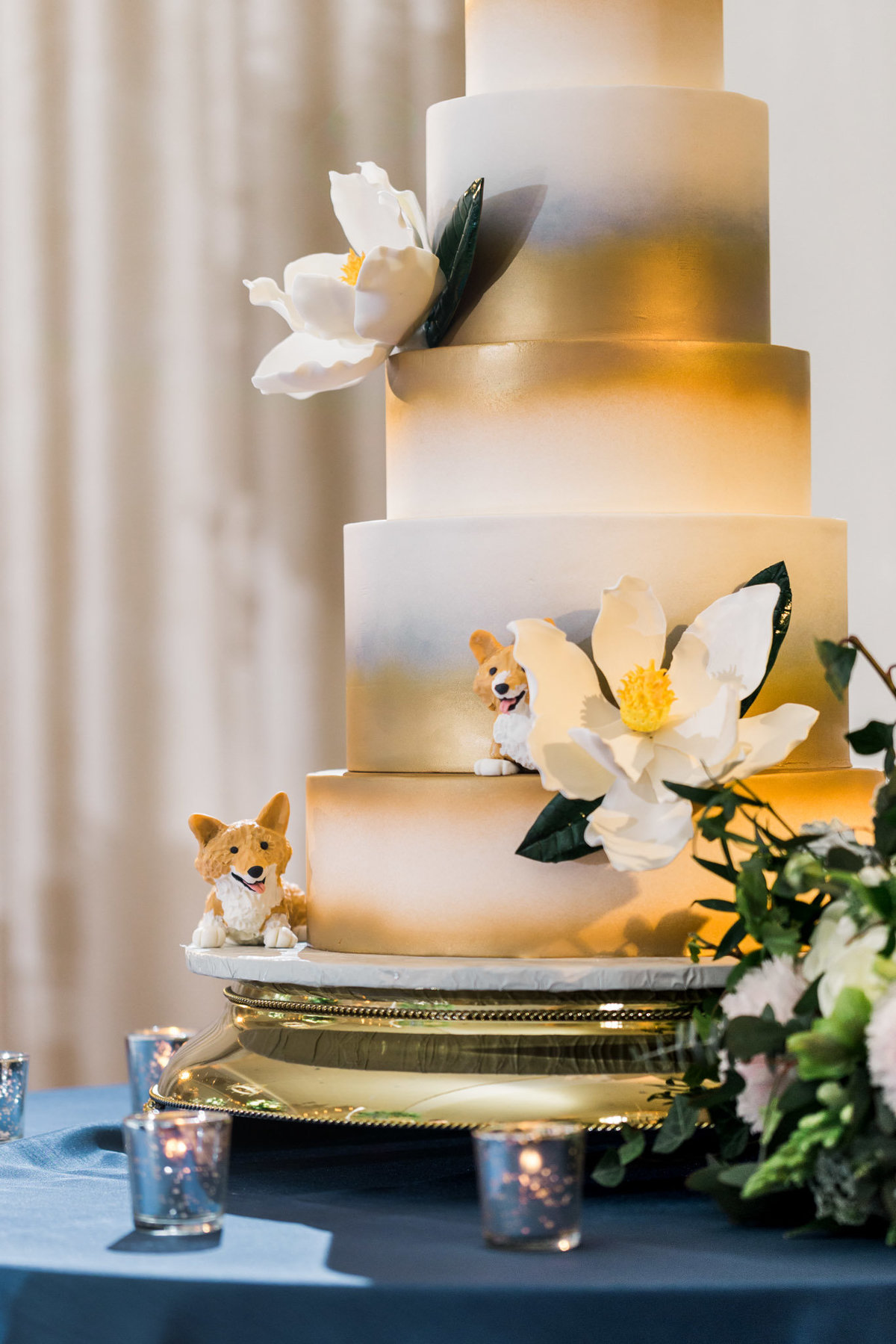 This bride chose to incorporate her love of Corgis's into her wedding cake. Photo by luxury destination wedding photographer Rebecca Cerasani.