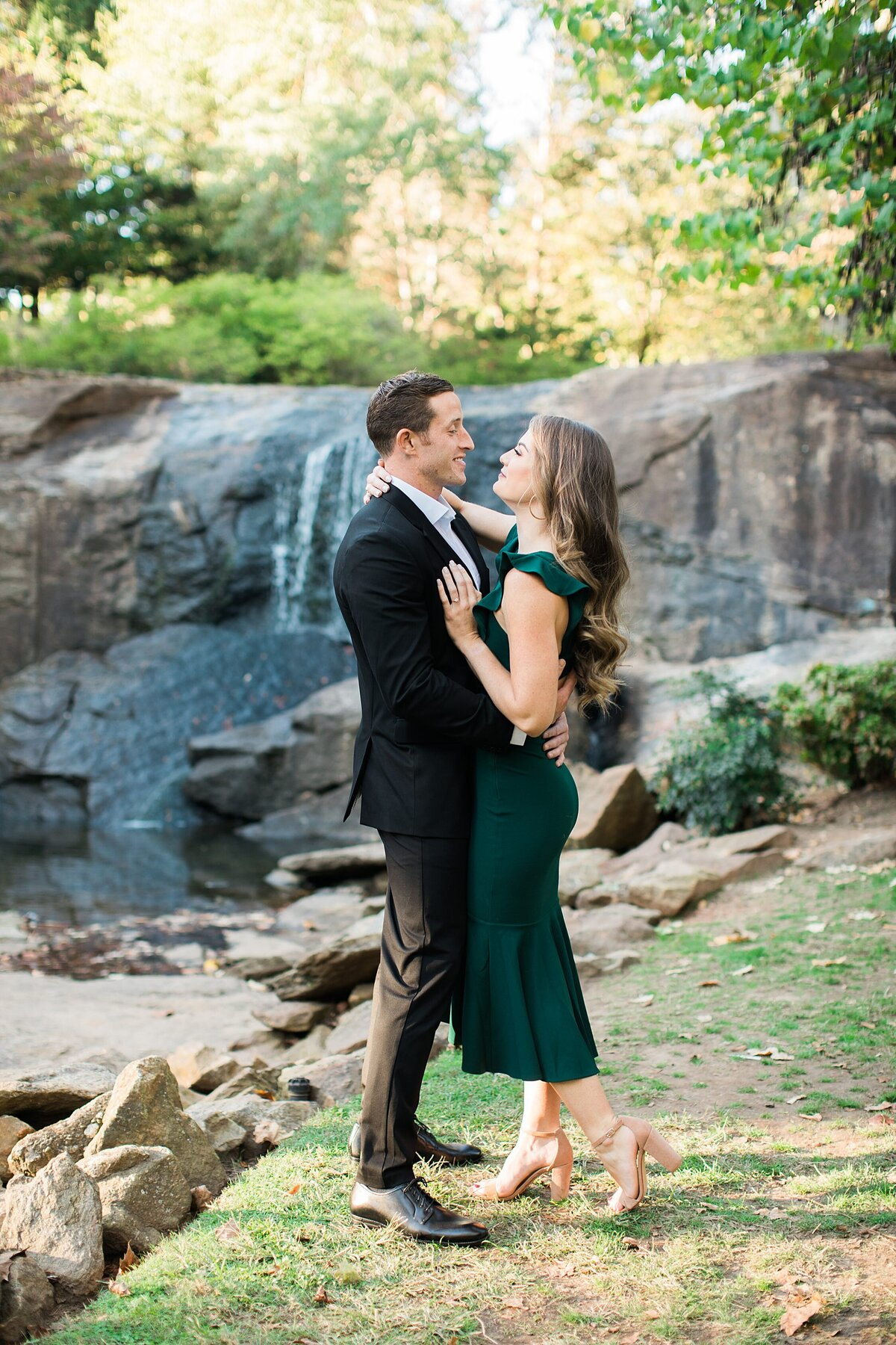 Greenville  Wedding Photographer, couple standing with their arms around each other
