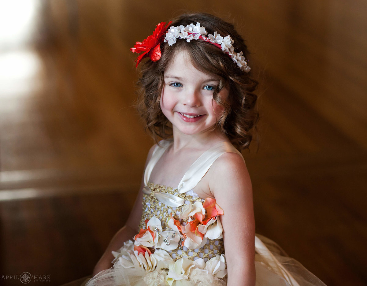 Sweet little flower girl wearing a flower crown at Manor House in Littleton Colorado