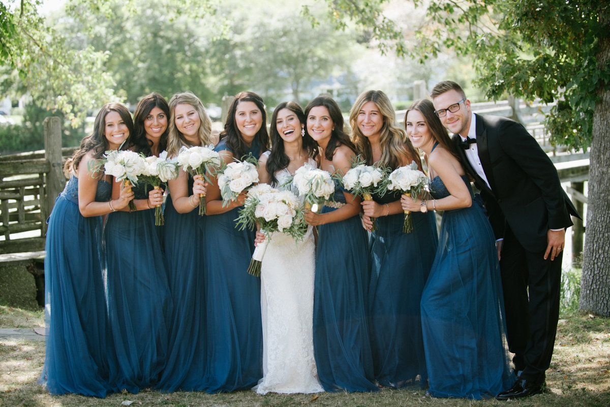 Bridal party with man of honor wearing blue dresses