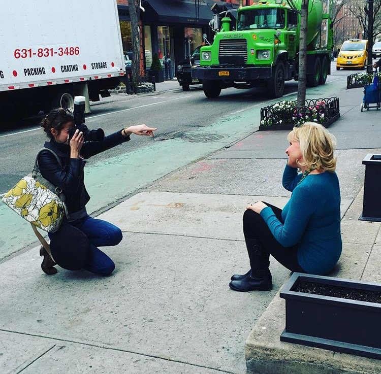Laura Volpacchio directs a client on the streets of NYC during a branding photography session