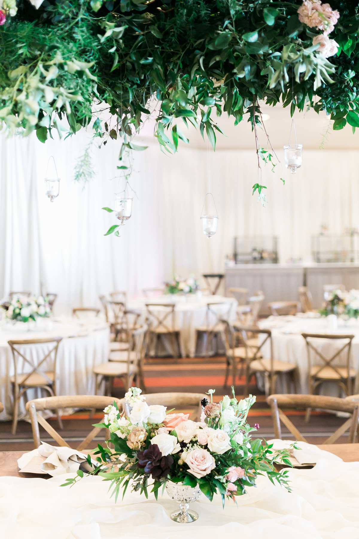 Hyatt Regency Lake Tahoe Wedding in ballroom with rustic wood chairs and floral centerpieces