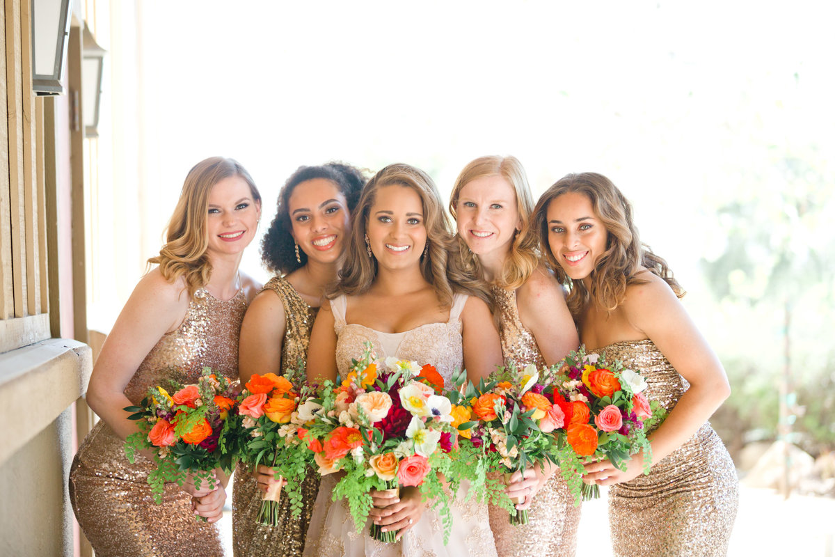 Bridal party of bridesmaids in rose gold dresses