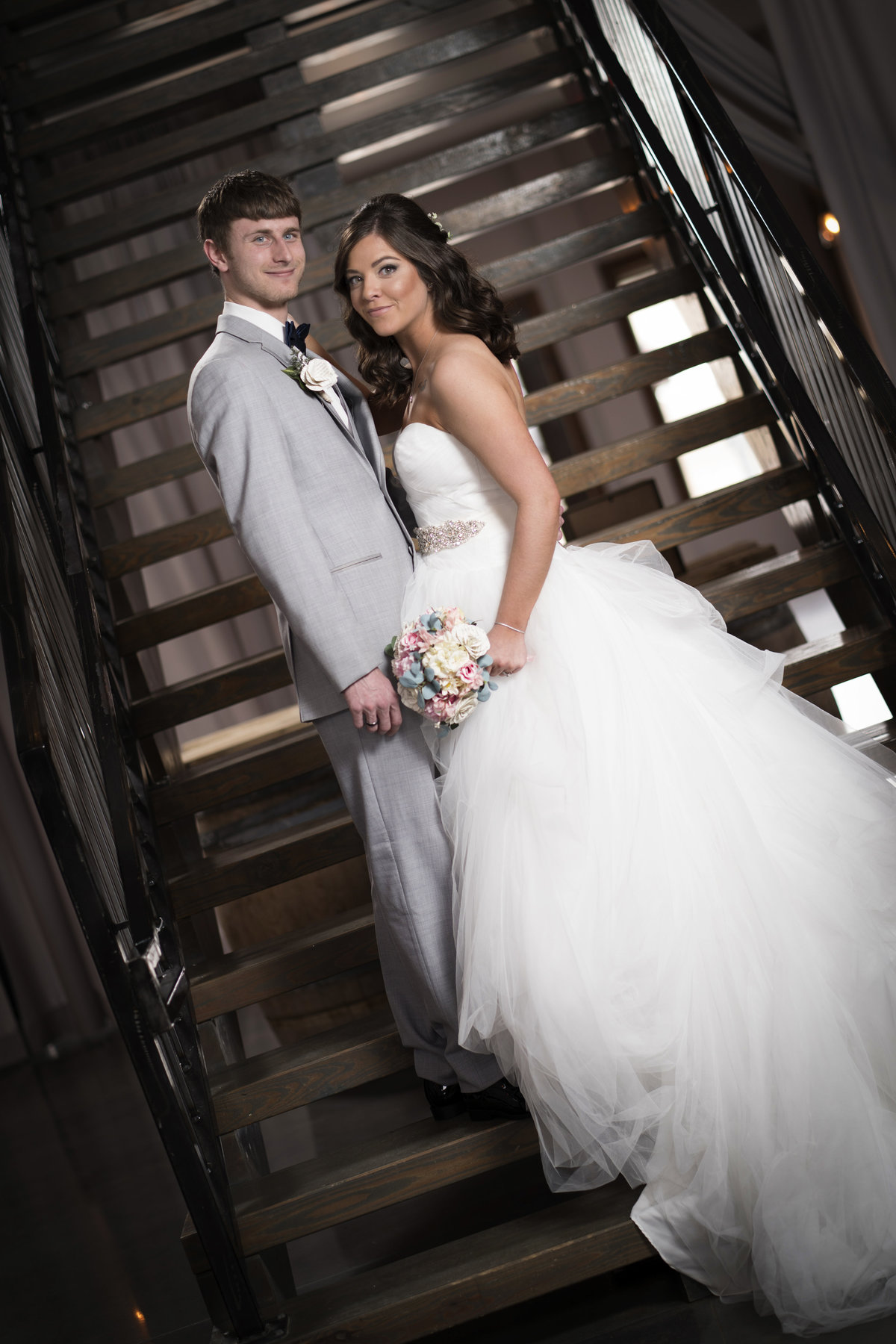 bride and groom formal pre ceremony on stairs blue haven barn