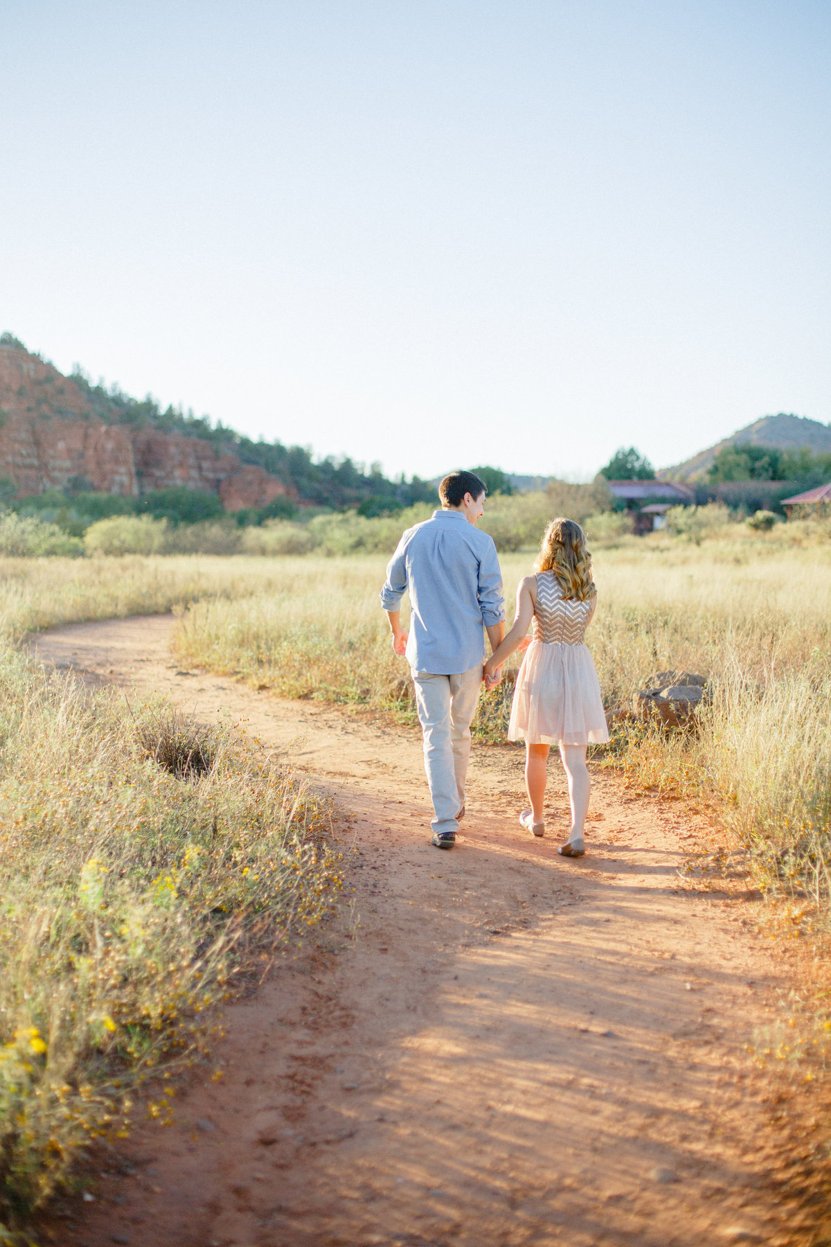walking down dirt path in sedona arizona park for engagement photography