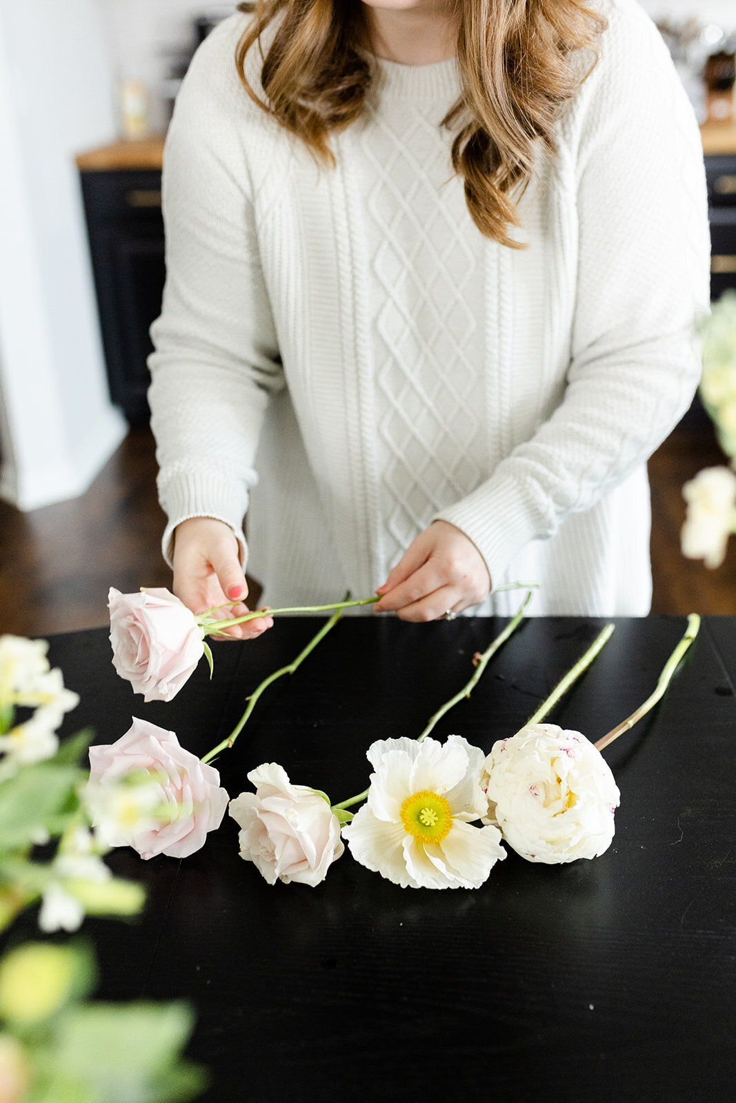 Hannah sorting floral stems for branding session