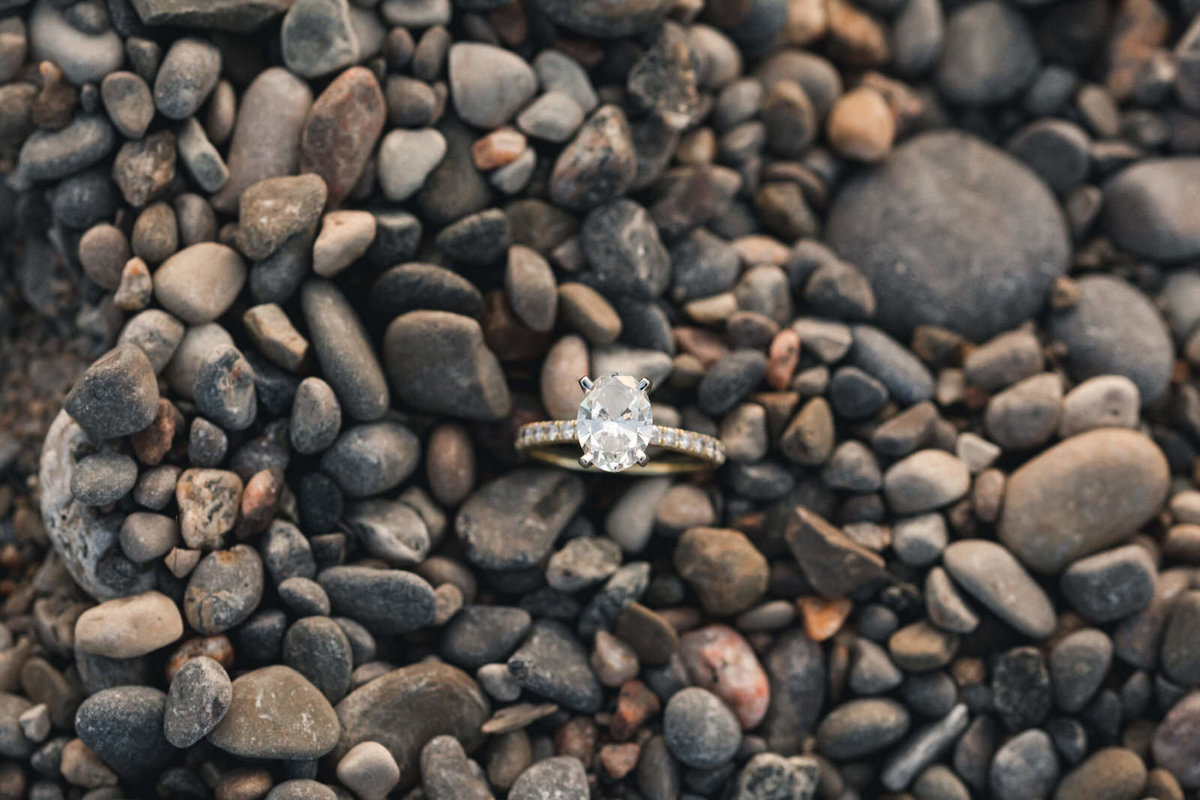 oval-engagement-ring-on-the-rocks