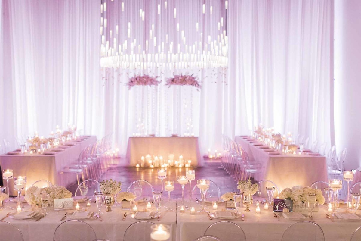 Lovely white wedding filled with light and candles make for a truly romantic evening