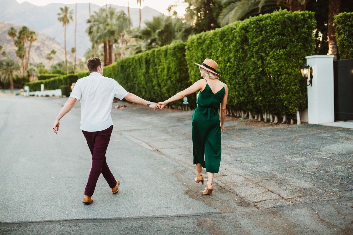 couple-walking-down-street-palm-springs