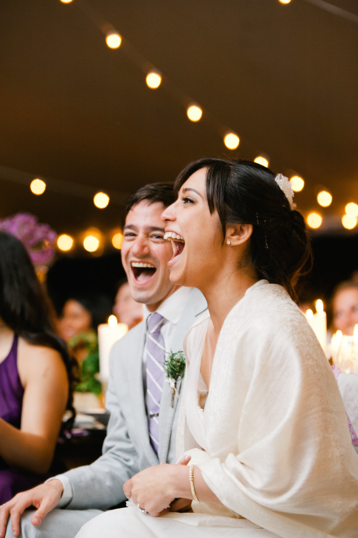Bride and groom react to toast