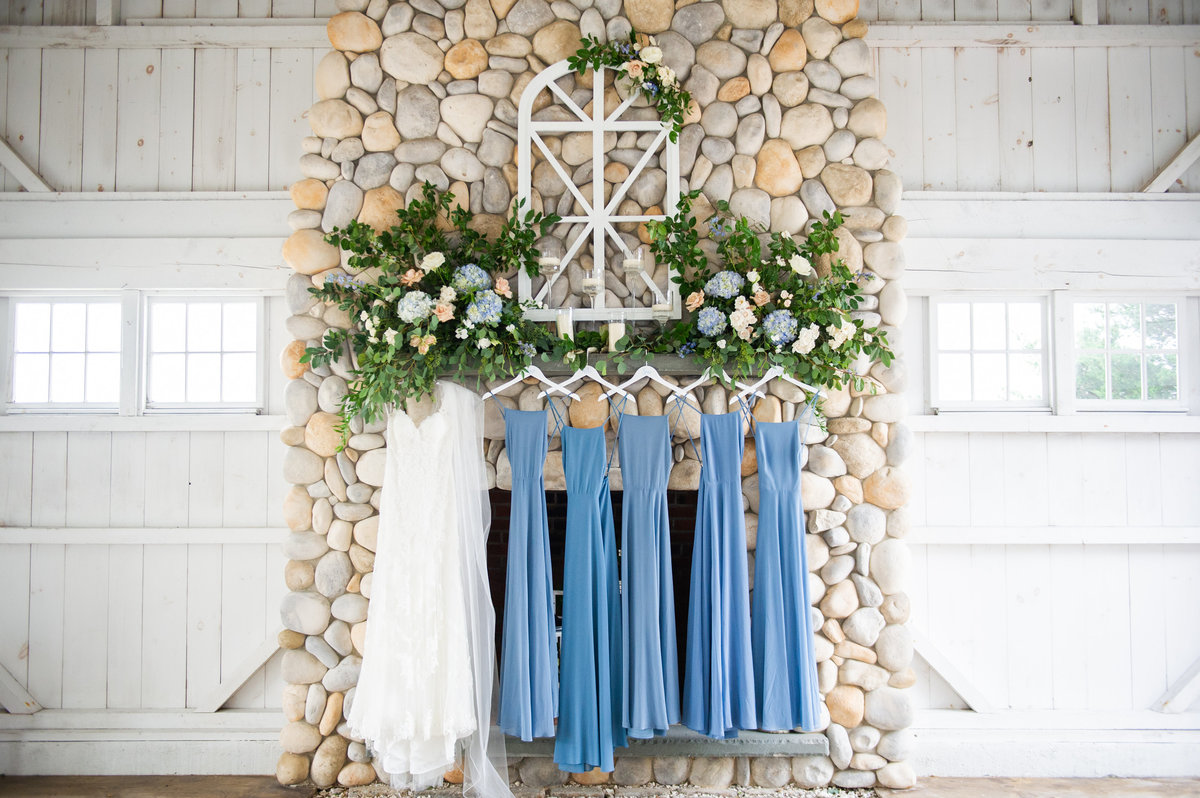 blue bridesmaid dressed hung on mantel