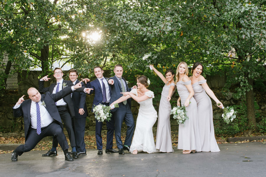 fun bridal party pose at liberty state park