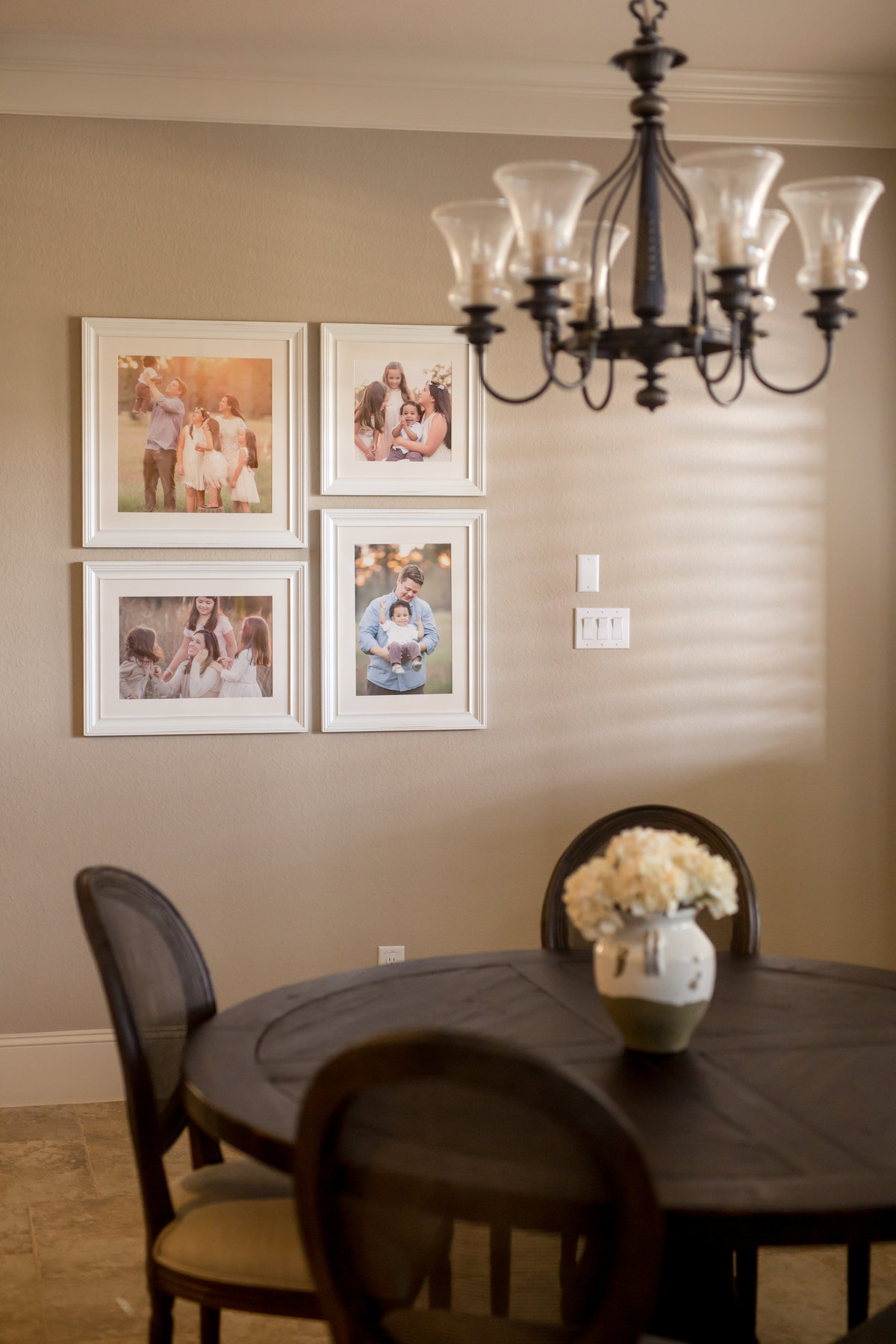 collection of framed photos in a woodlands kitchen