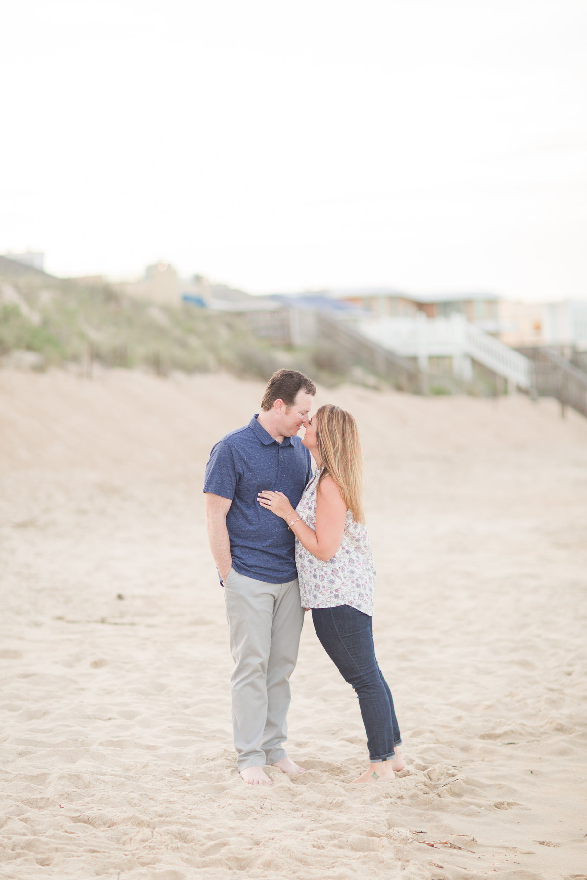 couple posing  nose to nose  for virginia beach engagement session