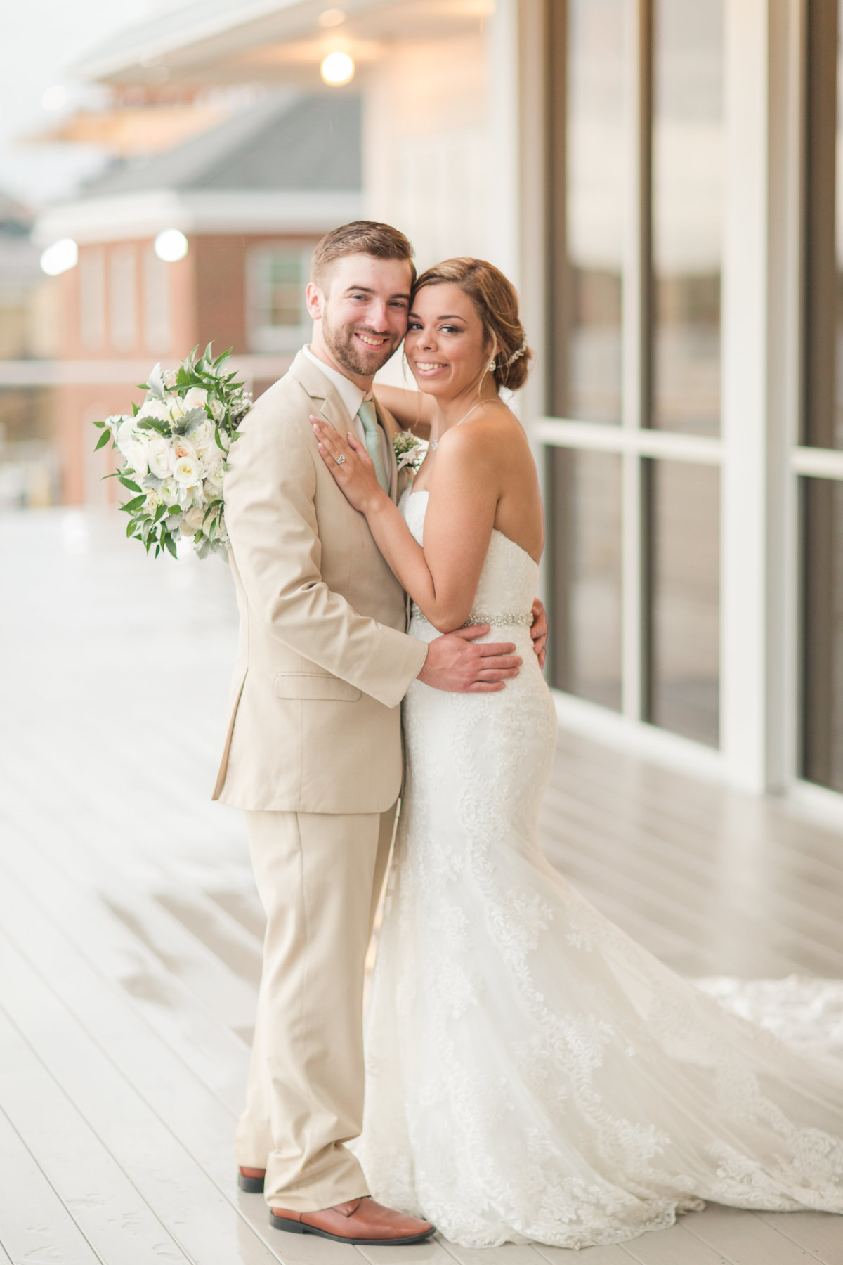 bride and groom smiling happily at Lesner Inn