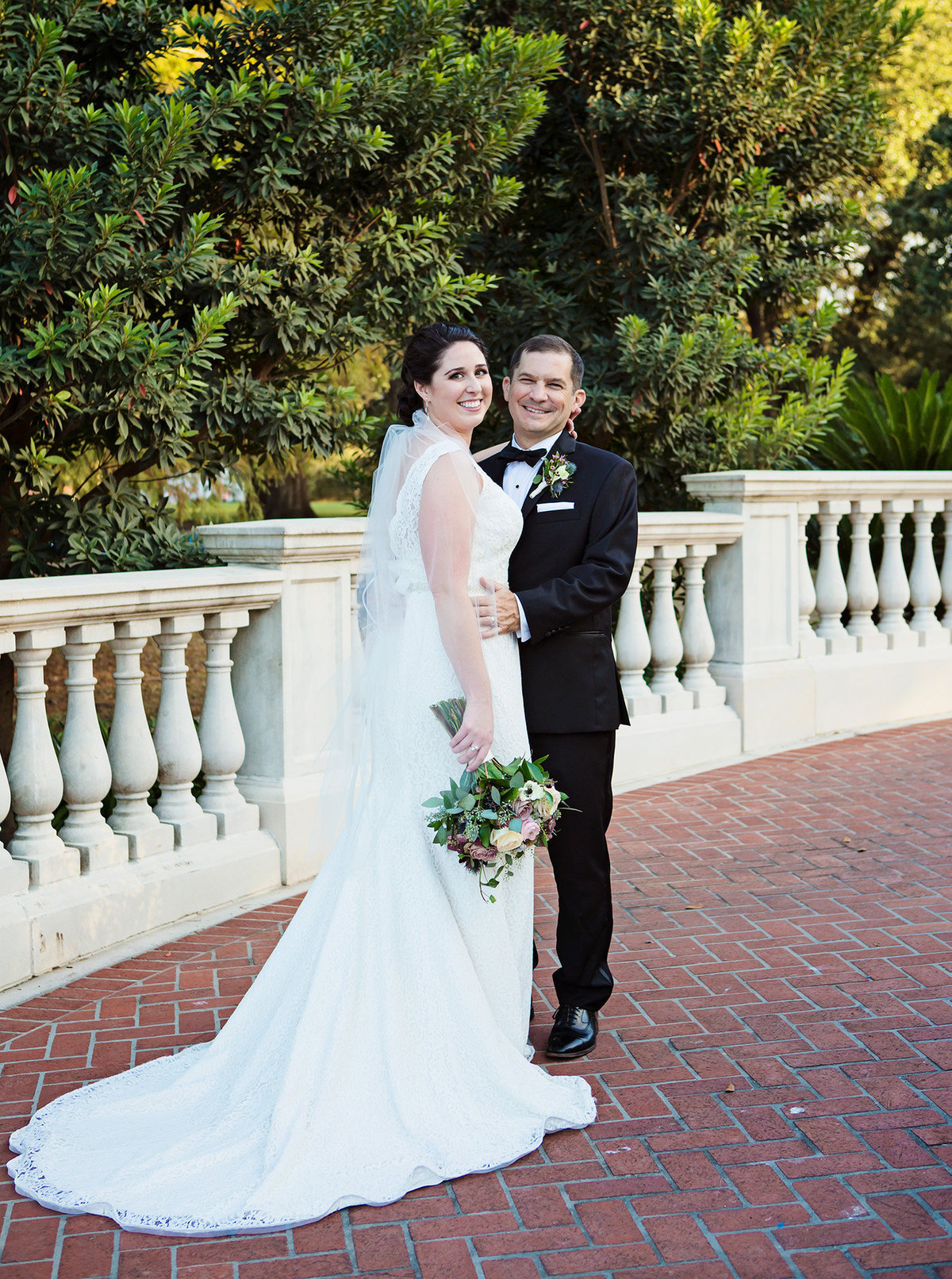 new orleans wedding couple on brick pathway of the Newman Bandstand