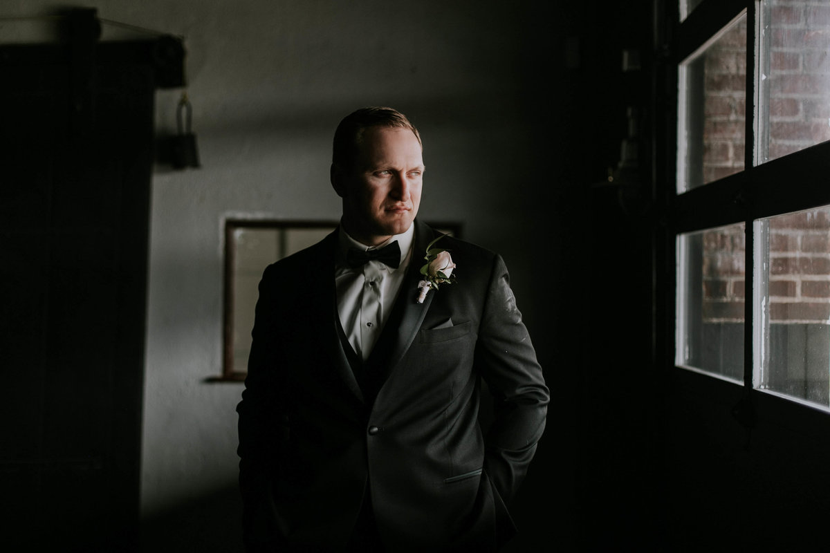 Groom stares out window at Biltwell Center