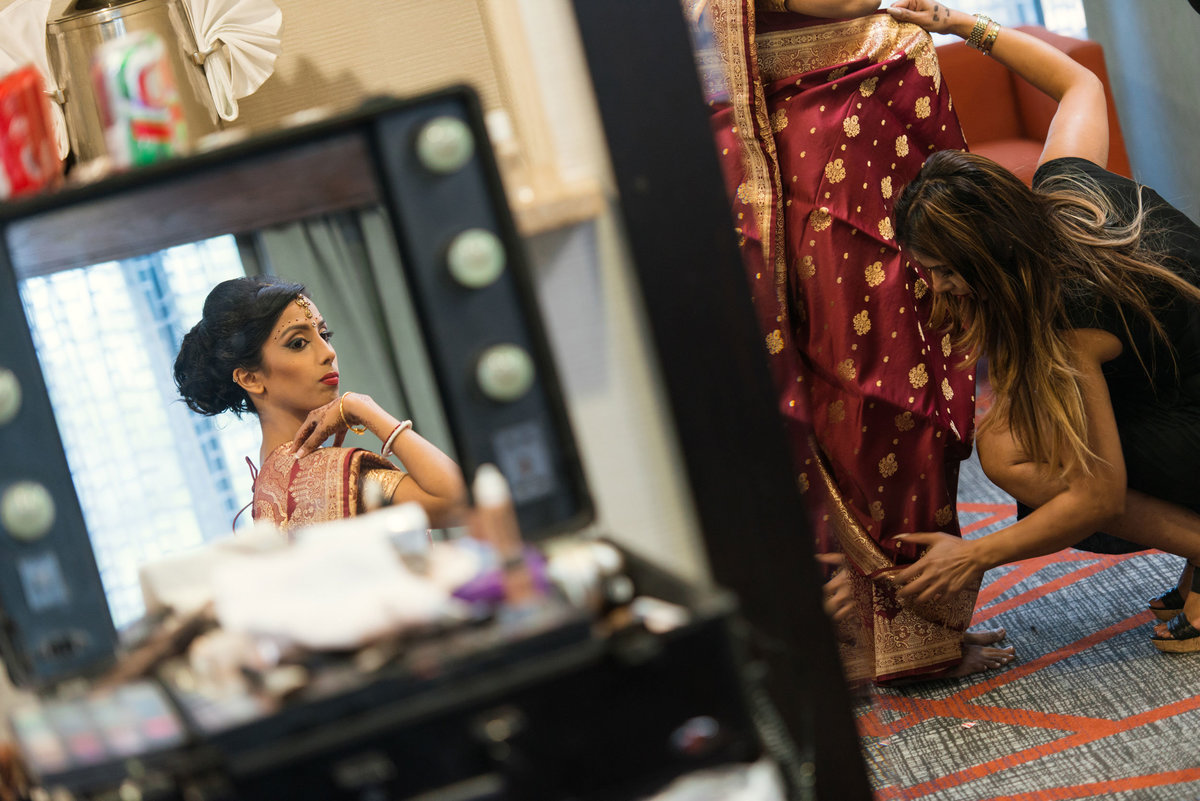 bride looking at her makeup at Huntington Hilton