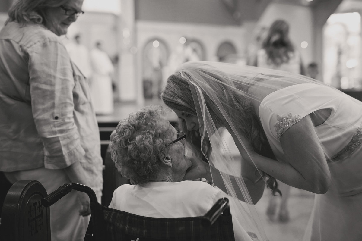 candid wedding photography bride with grandma black and white intimate moment before the wedding, Christ the King Church, Ann Arbor, Michigan,  wedding photographer Charlene Gurney