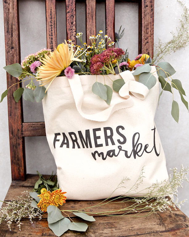 cotton farmers market bag overflowing with florals instagram marketing photographer