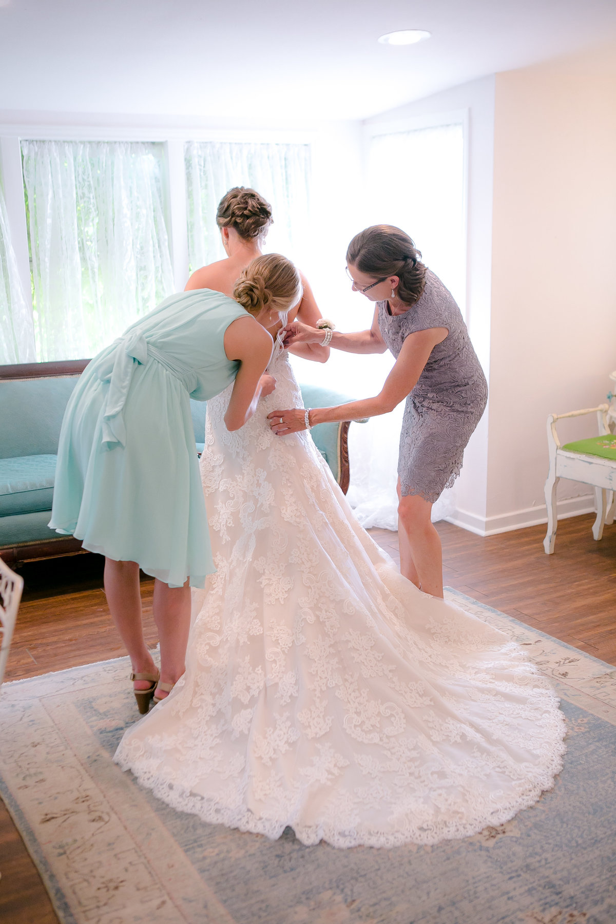Austin Family Photographer, Tiffany Chapman Photography bride getting dress on photo