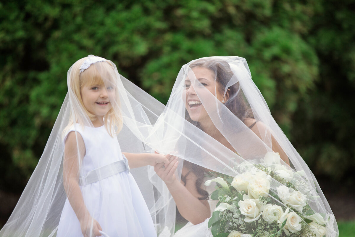 photo of bride with flower girl being silly for wedding at The Carltun