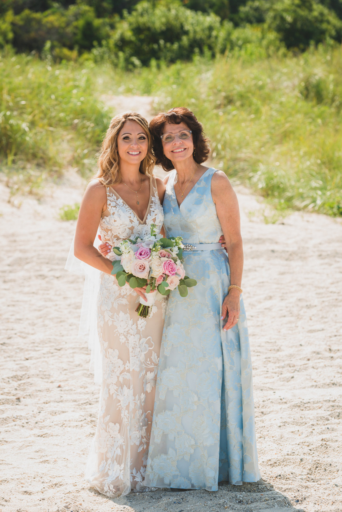 photo of bride with mom on the beach from wedding at Pavilion at Sunken Meadow