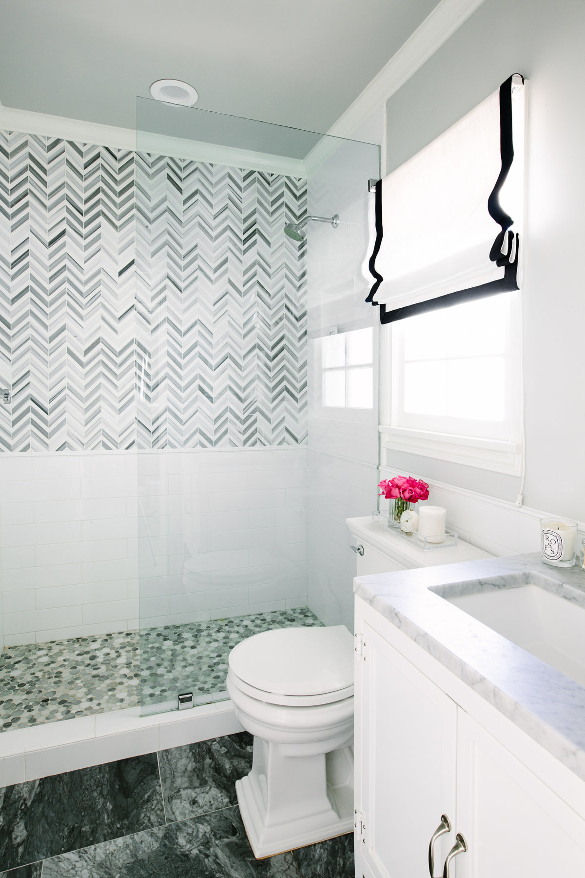 Bathroom with chevron marble tile