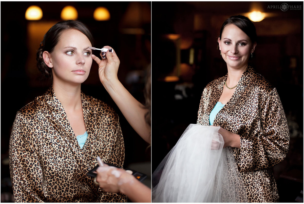 A bridemaid wearing a leopard print robe gets her make up done in the suite before the mountaintop wedding