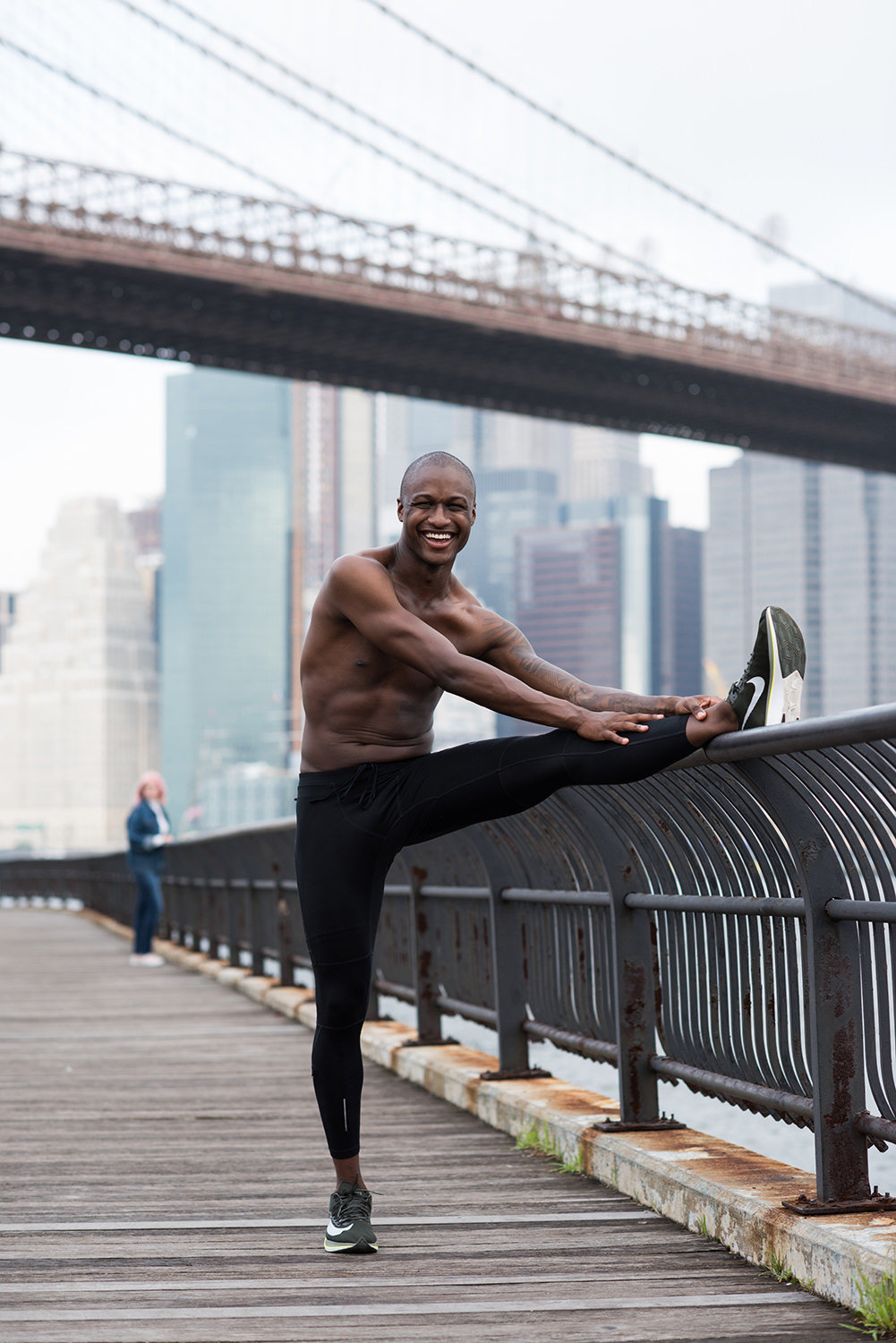 man hamstring stretch dumbo new york bridge running fitness male