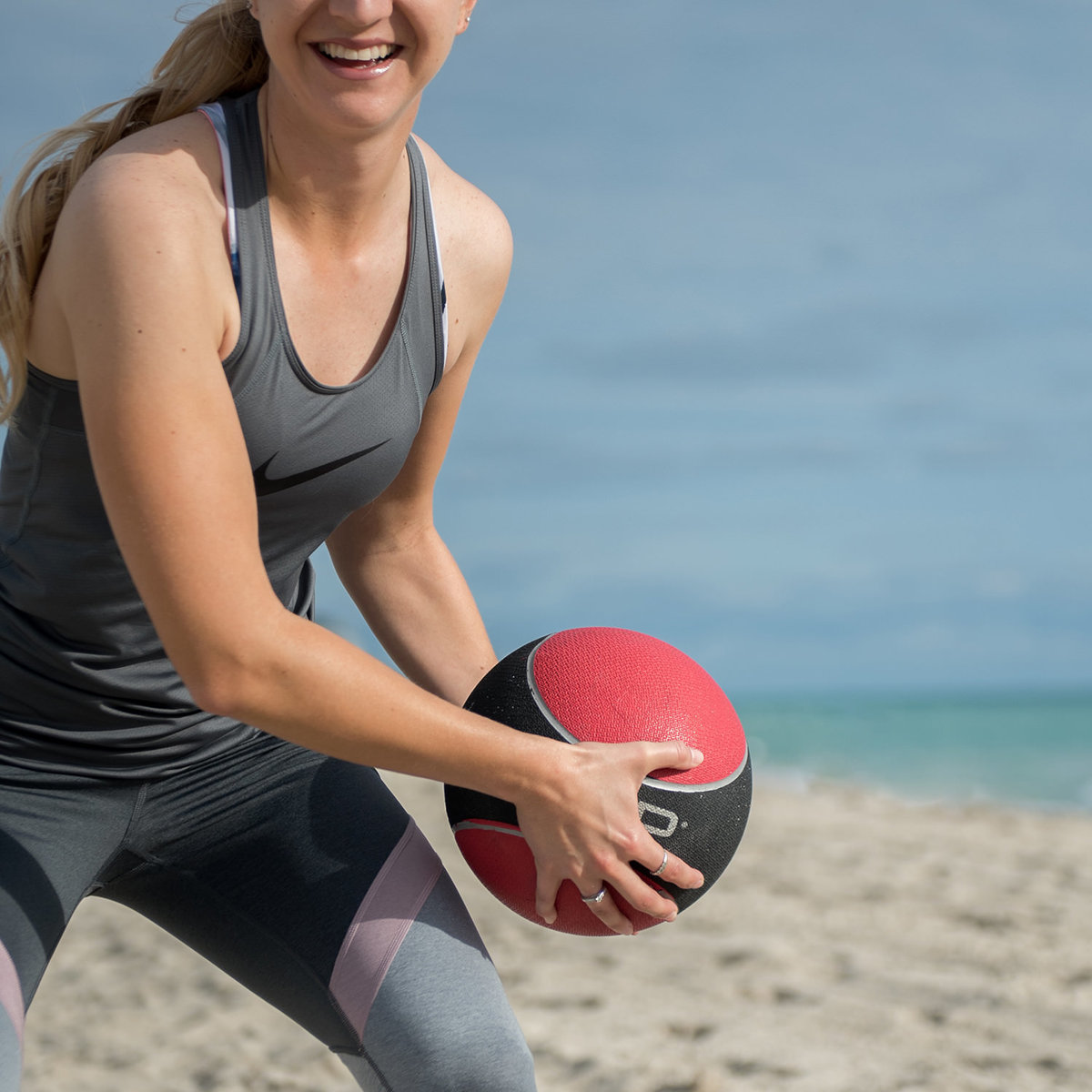 woman catching medicine ball