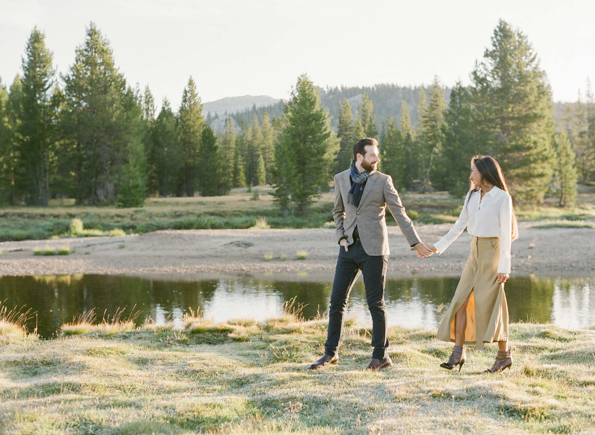 23-KTMerry-destination-engagement-session-Yosemite-couple-walking