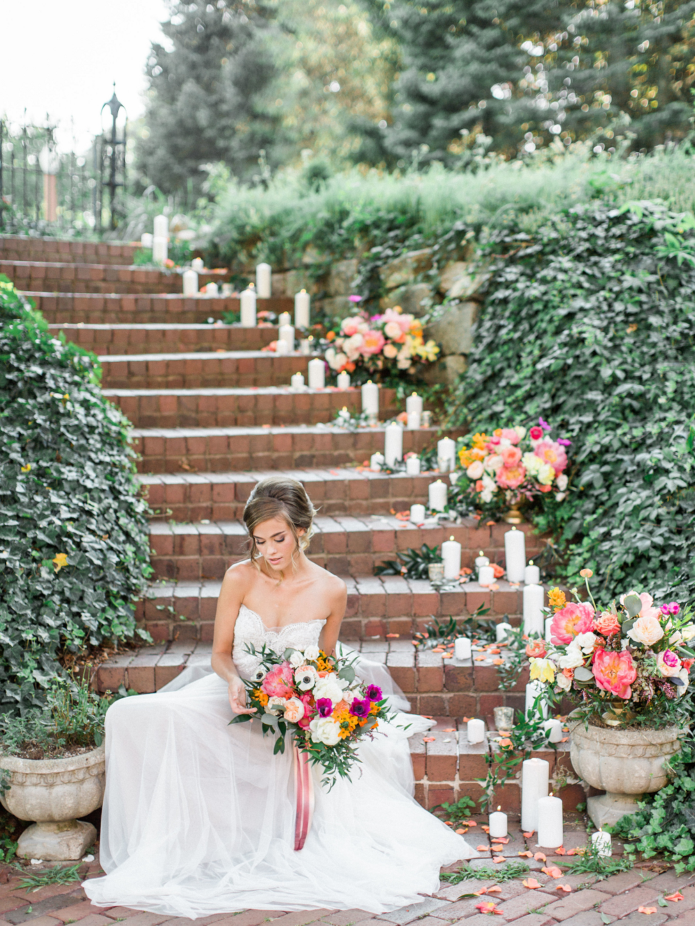 Whimsical Summer Wedding Styled Shoot at Henderson Castle Featured in WeddingDay Magazine Bride on staircase with candles