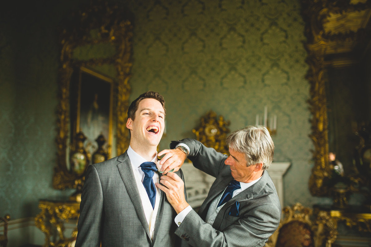 groom in tails and dad his fixing his cravat. taken at allerton castle wedding photographer