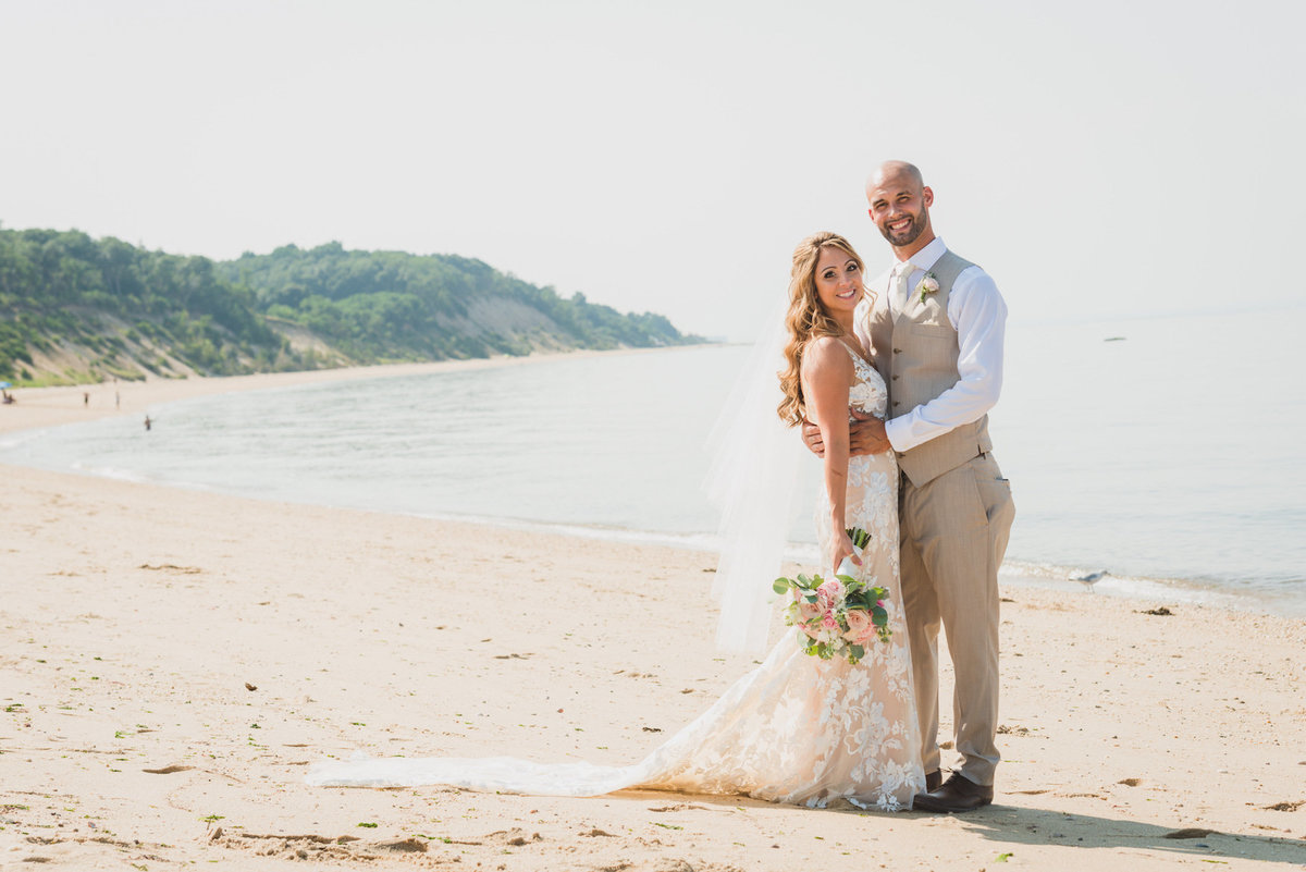 bride and groom on the beach from wedding at Pavilion at Sunken Meadow