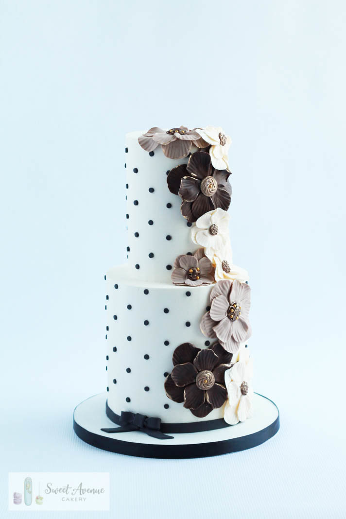 white wedding cake with black polka dots and brown sugar leather flowers, Hamilton ON wedding cakes