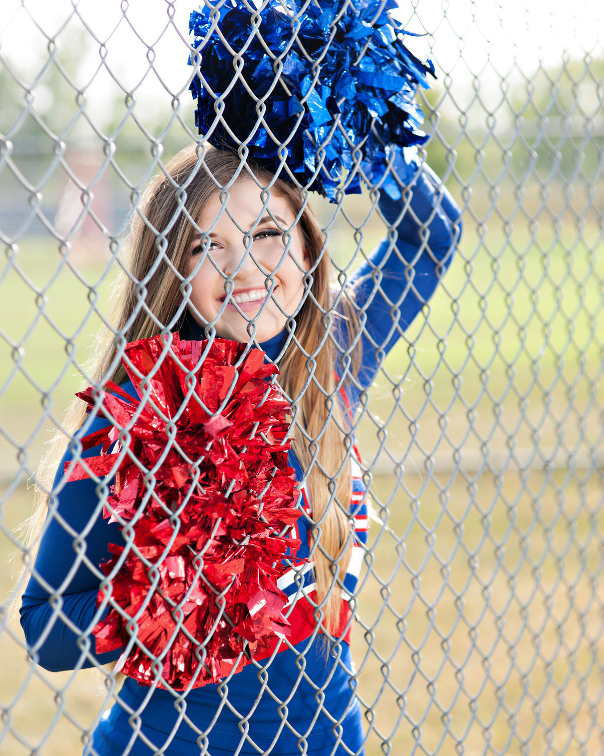 mason michigan senior portraits of cheerleader on football field