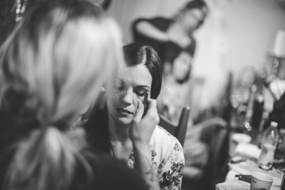 bride having make up done before wedding ceremony at Vista West Ranch venue in the Texas Hill Country