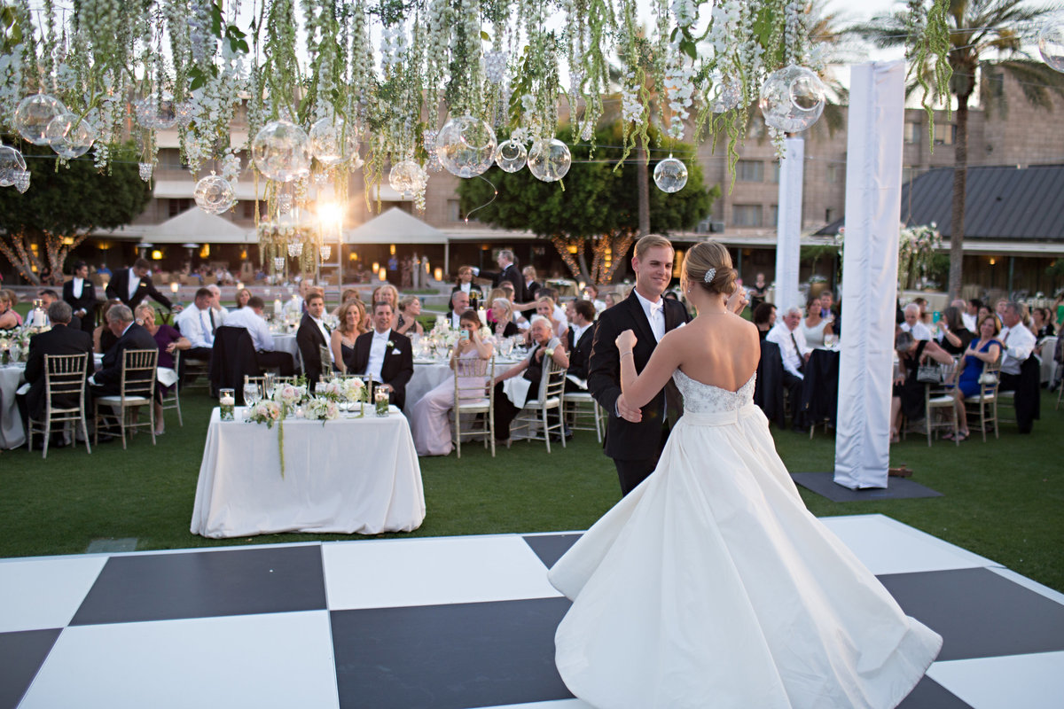 Arizona Biltmore Resort Paradise Valley wedding Scottsdale Wedding Outdoor Wedding Lawn Garden Petal Pushers Florist Ashley gain Weddings Arizona wedding planner Scottsdale wedding planner Top wedding planner  Classic cakes and confections Black and white dance floor Classic party rentals Jj band Celebrations in paper Stephanie fay photography