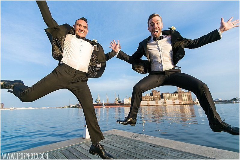 gay grooms jumping for joy in fells point baltimore wedding