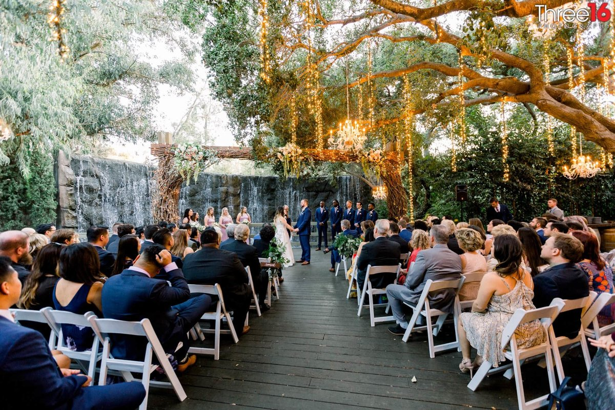 Beautiful wedding ceremony under tree branches at Calamigos Ranch