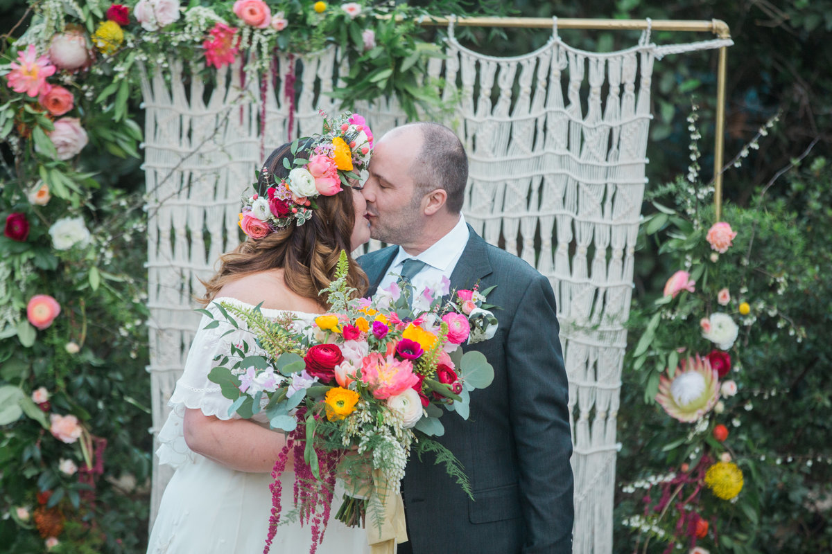 First kiss as husband and wife at Madrona Manor in Healdsburg California