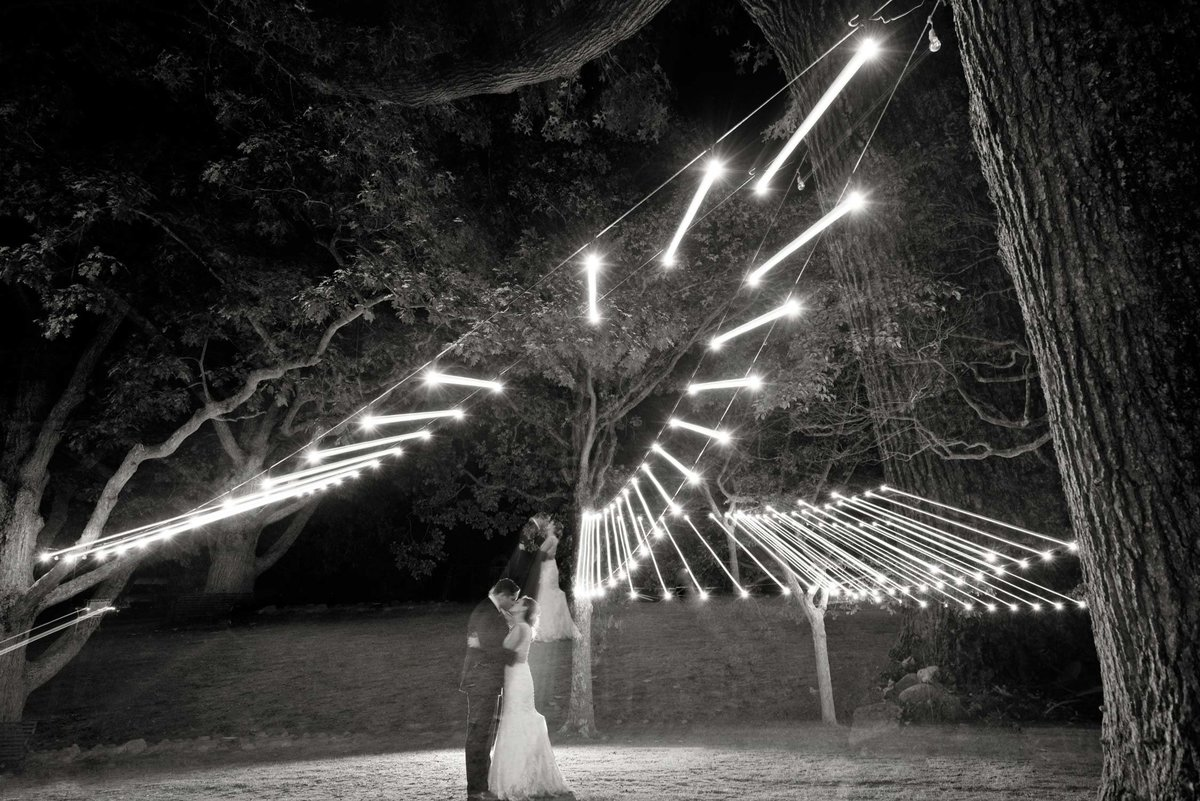 bride and groom under lights at The Ram's Head Inn