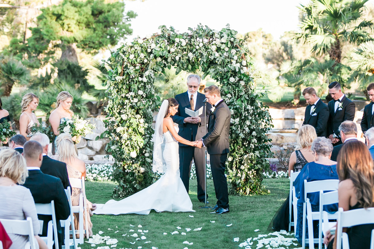 ceremony floral arch with greenery and white floral