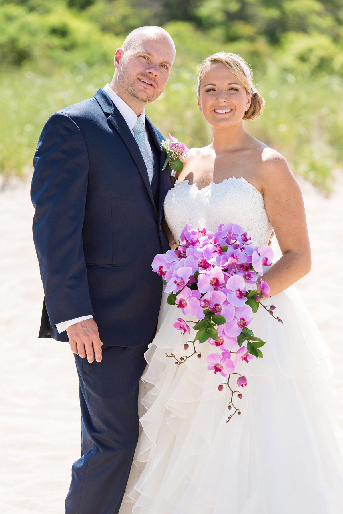 photo of bride and groom on the beach from wedding reception at Pavilion at Sunken Meadow